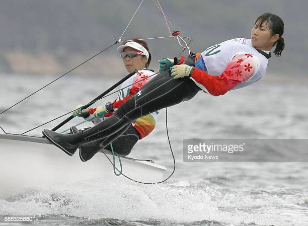 Japan's Ai Yoshida and Miho Yoshioka control their yacht in the first race of the women's 470 sailing event on Aug 10 during the Rio de Janeiro...