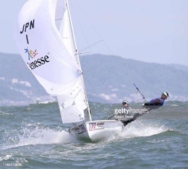 Japan's Ai Yoshida and Miho Yoshioka sail en route to finishing second in the women's 470 class world championships on Aug. 9 off Enoshima Island in...