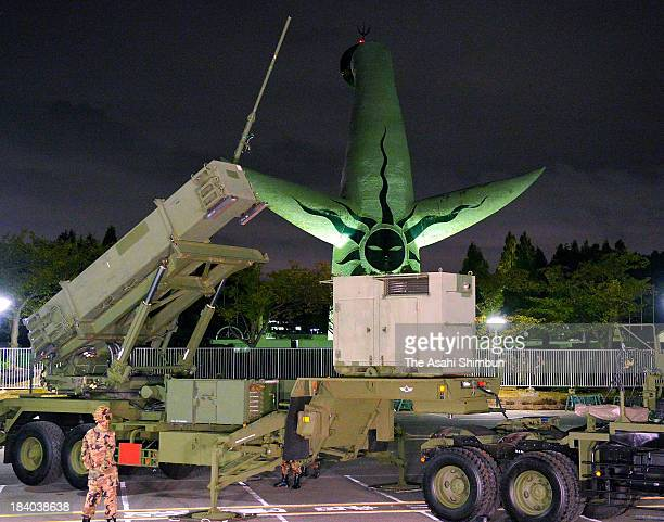 Japan's Air SelfDefense Force members set up Patriot Avanced Capability3 system during their drill in Expo '70 Commemorative Park on October 9 2013...