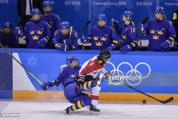 TOPSHOT Japan's Akane Hosoyamada chases the puck as Sweden's Maria Lindh falls in the women's classifications ice hockey match between Sweden and...