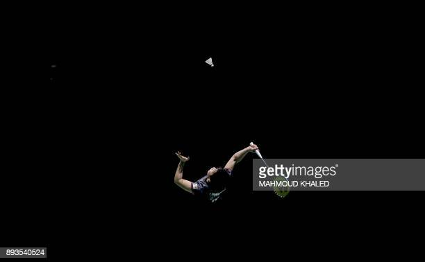 TOPSHOT Japan's Akane Yamaguchi returns the shot to India's Pusarla V Sindha during the third day of the Dubai Badminton World Superseries Finals in...