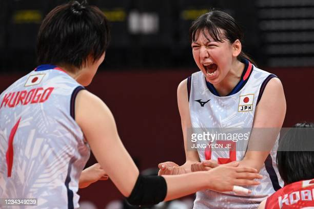 Japan's Aki Momii reacts after a point in the women's preliminary round pool A volleyball match between Japan and South Korea during the Tokyo 2020...