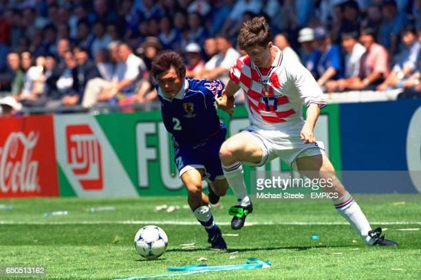 Japan's Akira Narahashi and Croatia's Robert Jarni battle for the ball