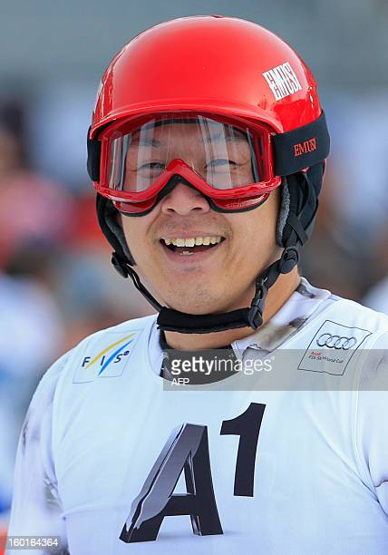 Japan's Akira Sasaki reacts after competing in the FIS World Cup men's slalom race on January 27 2013 in Kitzbuehel Austria AFP PHOTO / ALEXANDER...