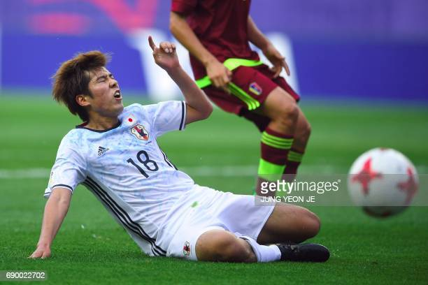Japan's Akito Takagi reacts after failing to score during their U20 World Cup round of 16 football match between Venezuela and Japan in Daejeon on...