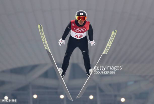 Japan's Akito Watabe competes in the nordic combined men's individual NH/10km jumping trial round at the Alpensia ski jump centre during the...