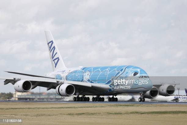 Japan's All Nippon Airways Airbus A380 aircraft called the 'Flying HONU' taxies upon its arrival at Narita International airport on March 21 2019...