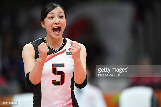 Japan's Arisa Sato celebrates a point during the women's qualifying volleyball match between Japan and Cameroon at the Maracanazinho stadium in Rio...