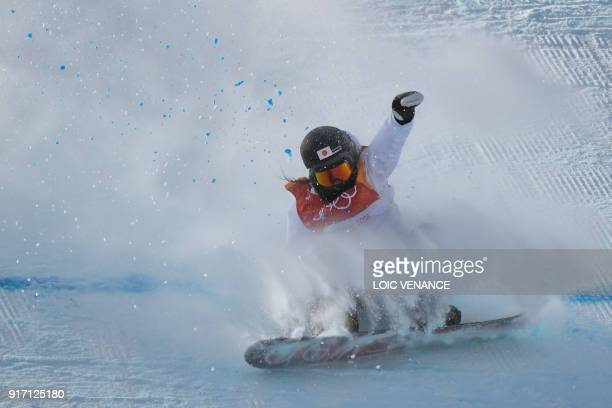 TOPSHOT Japan's Asami Hirono competes in a run of the women's snowboard slopestyle final event at the Phoenix Park during the Pyeongchang 2018 Winter...