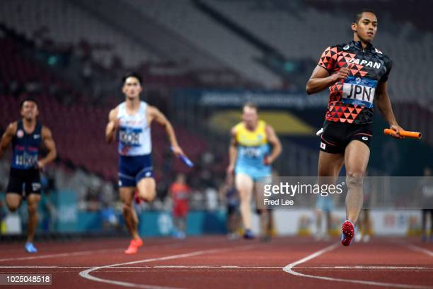 Japan's Aska Cambridge competes in a heat of the men's 4x100m relay athletics event during the 2018 Asian Games in Jakarta on August 29 2018