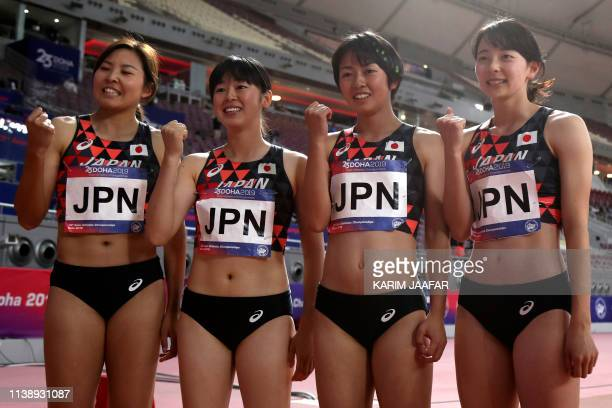 Japan's athletes celebrate after the women's 4x100m relay during the third day of the 23rd Asian Athletics Championships at Khalifa International...