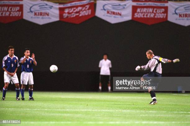 Japan's Atsushi Yanagisawa and Hiroaki Morishima face up to a free kick from Paraguay goalkeeper Jose Luis Chilavert