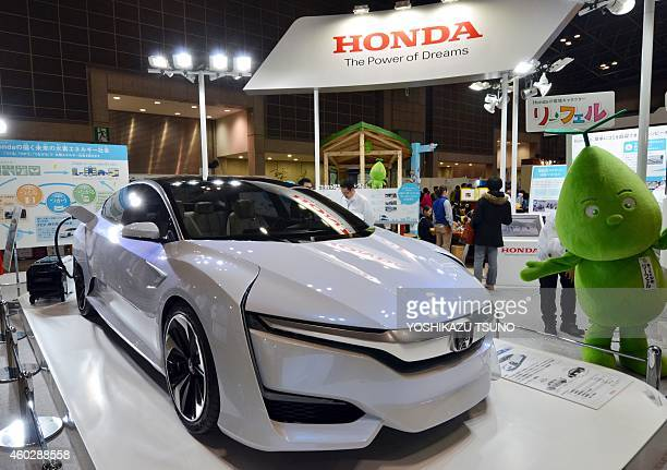 Japan's auto giant Honda Motor displays the company's fuel cell vehicle 'FCV concept' which can be driven over 700 kms with a charge of hydrogen at...