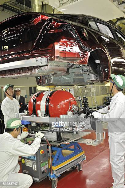 Japan's auto giant Honda Motor workers assemble a hydrogen tank unit to the next generation fuel cell vehicle 'FCX Clarity' at the company's new...