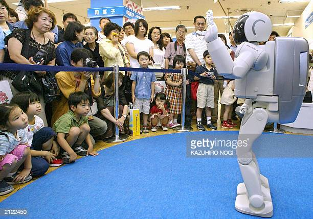 Japan's auto giant Honda's humanoid robot Asimo a store clerk for customer services for a oneyear contract with the Takashimaya department store...