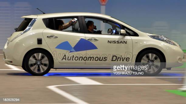 Japan's auto giant Nissan displays its new autonomous vehicle at the preview of the Ceatec electronics trade show in Chiba suburban Tokyo on...