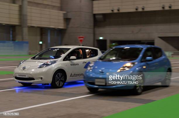 Japan's auto giant Nissan displays the new autonomous vehicle at the preview of the Ceatec electronics trade show in Chiba suburban Tokyo on...