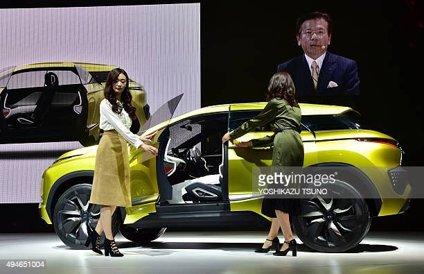 Japan's automaker Mitsubishi Motors introduces the electric SUV eX Concept model during a press preview at the Tokyo Motor Show in Tokyo on 28 2015...