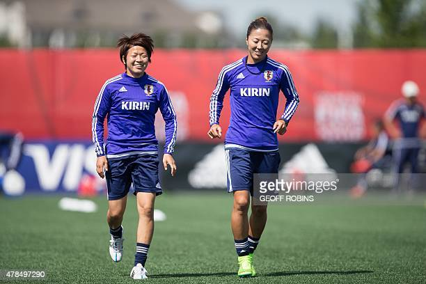 Japan's Aya Miyama and Yuki Ogimi warm up for the team's training session in Edmonton Canada on June 25 2015 Japan plays Australia in their quarter...