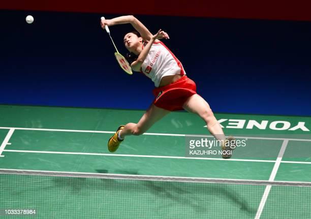 TOPSHOT Japan's Aya Ohori returns a shot against her compatriot Nozomi Okuhara during the women's semifinal match at the Japan Open Badminton...