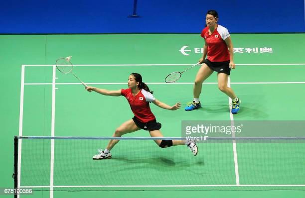 Japan's Ayaka Takahashi and Misaki Matsutomo hits a return during their women's doubles final match against Eye Rim KIM and YOO Have Won of Korea at...