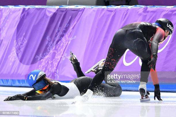 TOPSHOT Japan's Ayano Sato and Canada's Ivanie Blondin fall in the women's mass start semifinal speed skating event during the Pyeongchang 2018...