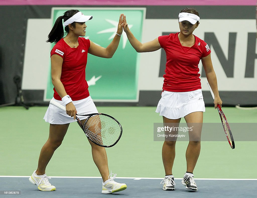Japan's Ayumi Morita shake hands with teammate Misaki Doi during their doubles match against Russia's Elena Vesnina and Ekaterina Makarova during day two of the Federation Cup 2013 World Group Quarterfinal match at Olympic Stadium on February 10, 2013 in Moscow, Russia.