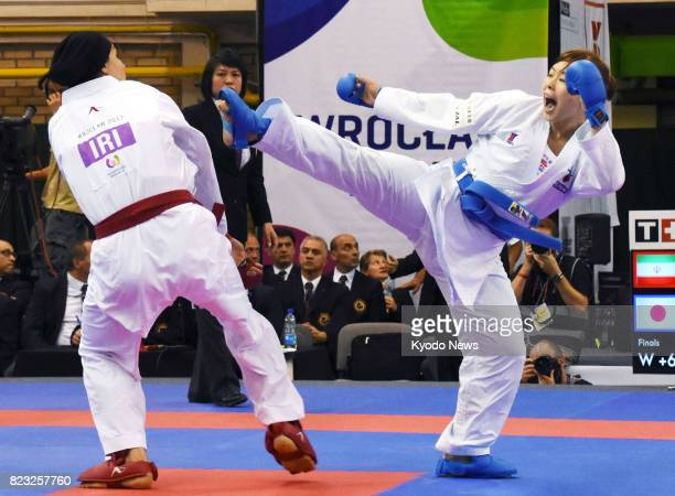 Japan's Ayumi Uekusa faces off against Hamideh Abbasali of Iran in the women's karate kumite 68 kg class final during the World Games in Wroclaw...