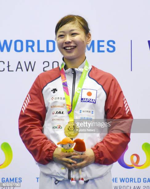 Japan's Ayumi Uekusa smiles after winning gold in the women's karate kumite 68 kg class in the World Games in Wroclaw Poland on July 26 2017 ==Kyodo
