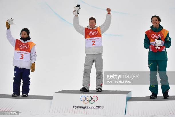 Japan's Ayumu Hirano US Shaun White and Australia's Scotty James celebrate on the podium during the victory ceremony after the final of the men's...