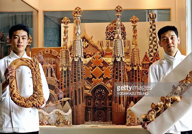 "Japan's bakery chair Kobeya Kitchen bakers Rintaro Miyashita and Yasuo Hatanaka display the 1.3 meter tall, 2 meter wide bread art ""Sagrada Familia"",..."