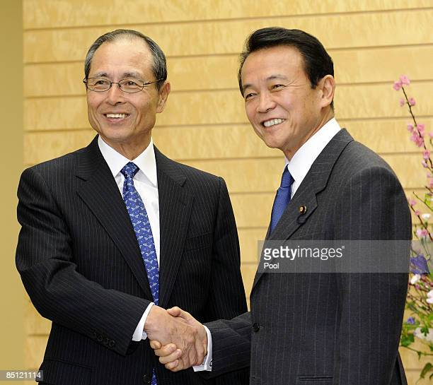 Japan's baseball legend Sadaharu Oh shakes hands with Japanese Prime Minister Taro Aso at Aso's office on February 26 2009 in Tokyo Japan Oh was...
