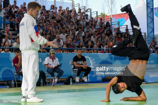 Japan's bboy Shigelix competes against Russia's bboy Bumblebee during a battle at the Youth Olympic Games in Buenos Aires Argentina on October 08...