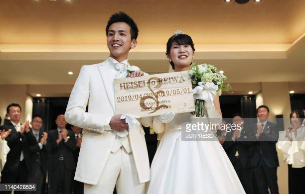 Japan's bride Mika Kobayashi and groom Tsubasa Moriya hold their wedding ceremony cross the final day of Heisei era and first day of Reiwa era in...