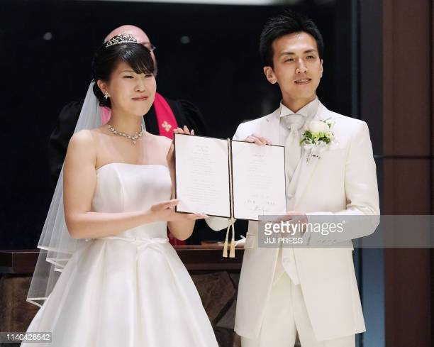Japan's bride Mika Kobayashi and groom Tsubasa Moriya hold their wedding ceremony cross the final day of Heisei era and first day of Reiwa era in...
