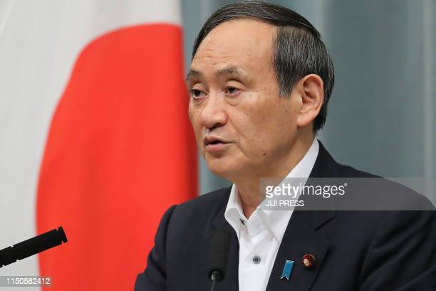 Japan's Cabinet Secretary Yoshihide Suga speaks during a press conference after 68magnitude earthquake hit the northwest of Japan at the prime...