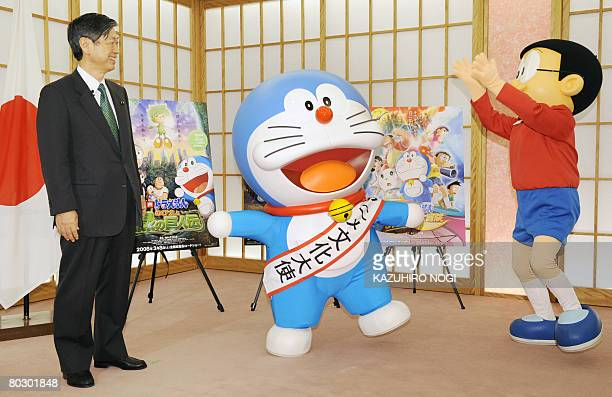 Japan's cartoon character Doraemon who has been appointed as the nation's first Anime Ambassador and his partner Nobita celebrate during an...