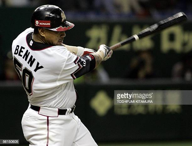 Japan's Chiba Lotte Marines outfielder Benny Agbayani hits a single to return two runners in during third innings of the final game of the Asia...
