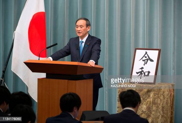 Japan's Chief Cabinet Secretary Yoshihide Suga announces the new era name Reiwa during a press coference at the prime minister's office in Tokyo on...