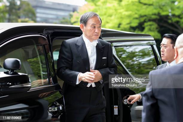 Japan's Chief Cabinet Secretary Yoshihide Suga arrives for Emperor Naruhito's ceremony for inheriting the Imperial Regalia and Seals at the Imperial...
