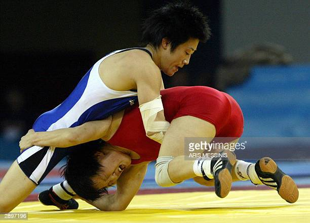 Japan's Chiharu Icho fights Russia's Lorisa Oorzhak during an International women's Wrestling Tournament at the Ano Liosia Olympic Hall in Athens, 24...