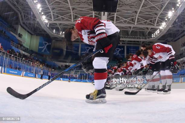 Japan's Chiho Osawa and her teammates bow after winning the women's classifications ice hockey match between Sweden and Japan during the Pyeongchang...