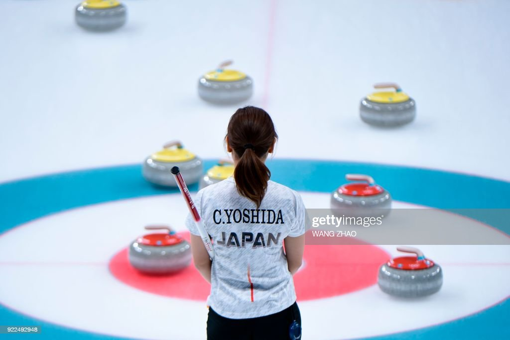 Japan's Chinami Yoshida looks at the stones during the curling women's round robin session between Switzerland and Japan during the Pyeongchang 2018 Winter Olympic Games at the Gangneung Curling Centre in Gangneung on February 21, 2018. / AFP PHOTO / WANG Zhao