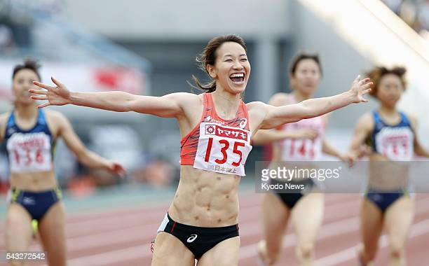 Japan's Chisato Fukushima finishes first in the women's 200 meters at the national championships in Paloma Mizuho Stadium in Nagoya central Japan on...