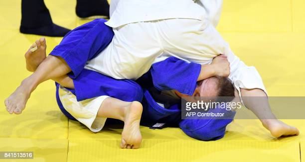 Japan's Chizuru Arai competes with Slovenia's Anka Pogacnik during their match in the womens 70kg category at the World Judo Championships in...