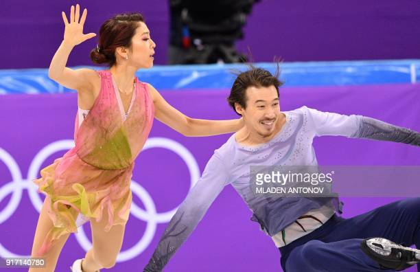 Japan's Chris Reed falls beside Japan's Kana Muramoto as they compete in the figure skating team event ice dance free dance during the Pyeongchang...