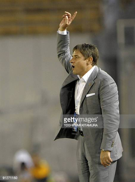 Japan's club team Nagoya Grampus head coach Dragan Stojkovic instructs his players during the second half of their AFC Champions League quarter-final...