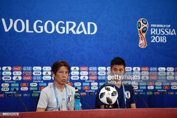 Japan's coach Akira Nishino and Japan's goalkeeper Eiji Kawashima attend a press conference on the eve of the Russia 2018 World Cup Group H football...