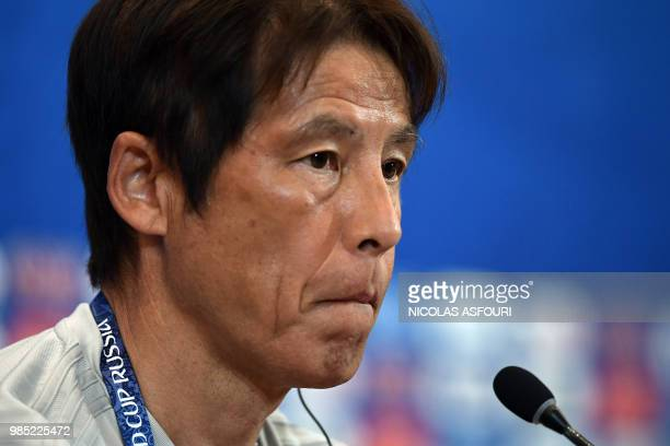 Japan's coach Akira Nishino attends a press conference on the eve of the Russia 2018 World Cup Group H football match between Japan and Poland at the...