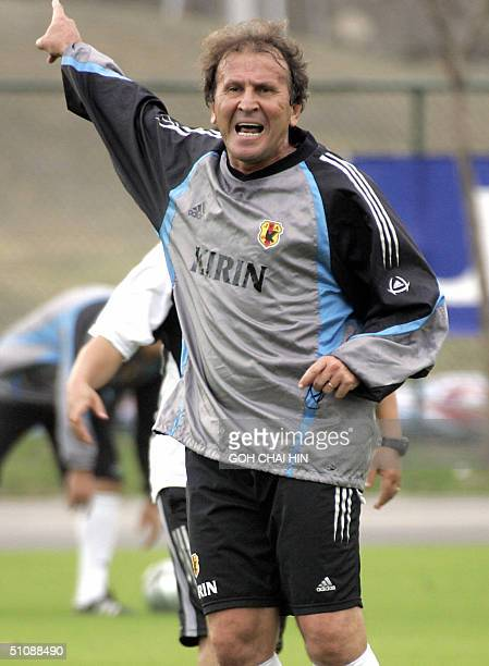 Japan's coach the legendary former Brazilian international Zico shouts instructions to his players during a training session 21 July 2004 in the...